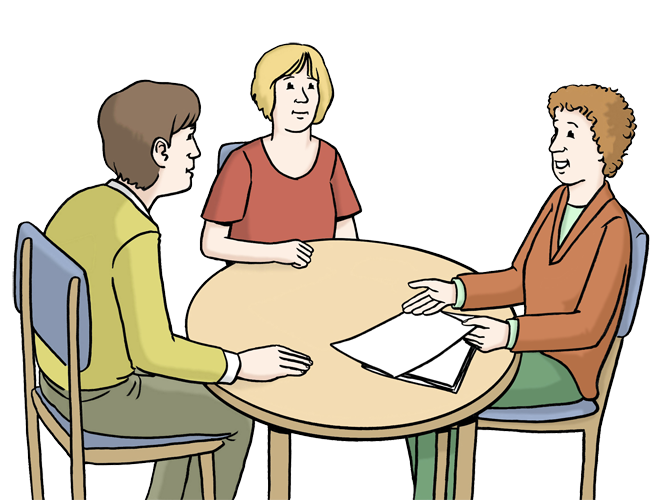 Eine Person berät an einem Tisch zwei weitere Personen